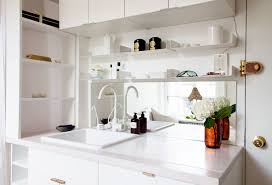 mini in manhattan home tour lonny tucked right next to the front door the apartment s single sink serves both the kitchen