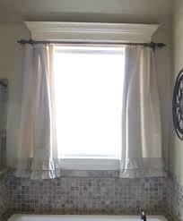 frameless mirror bathroom window treatments white tile wall bronze