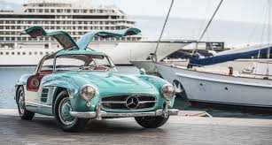 mercedes 300sl this mercedes 300sl gullwing is a cyan coloured bird of paradise