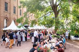 visitors and stalls at the markets hyde park barracks