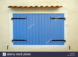 blue wooden sunblinds window shutters of traditional house