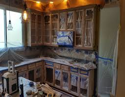 how to prep cabinets for painting how to mask wall cabinets for spray painting dengarden