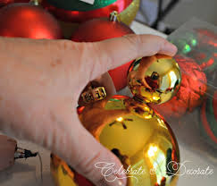 see how to glue together dollar store ornaments to make this