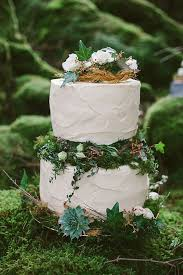wedding cake greenery picture of buttercream wedding cake with greenery and moss