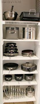 how to organize pots and pans in a cabinet 10 awesome tips for organizing pots and pans a cultivated