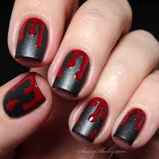 packapunchpolish caution tape with blood splatter nail art with