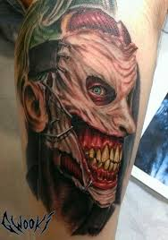 zombie joker face tattoo on leg by gwooki