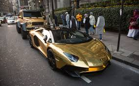 golden fast cars gold plated mercedes bentley and lamborghini flown to london by