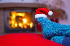 feet in woollen blue socks and santa hat stock photo image