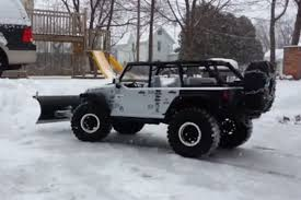 jeep wrangler snow video r c snowplow does the job just like the real thing off