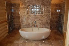 5 bathroom a large stone bath and double rain shower picture