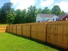 grass dog run behind cedar screen sprague residence cheap backyard