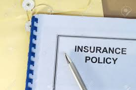 insurance policy folder on desk in office with pen and manila