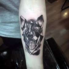 picture of geometric dog design tattoo on the arm