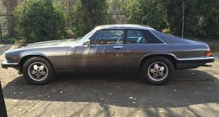 1984 jaguar xjs v12 being auctioned at barons auctions