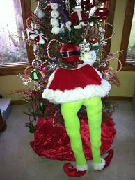 the grinch made with pvc pipes santa cape and lime green tights