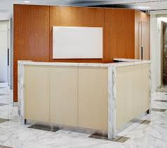 Custom Made Reception Desk Hand Crafted Angled Reception Desk With Stone Top And Wood Panel