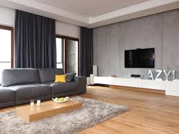 chic furniture in grey living room with fireplace facing wooden