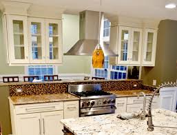 tile countertops upper kitchen cabinets with glass doors lighting