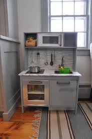 fascinating grey wooden stained with white faux stone backsplash