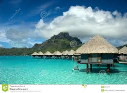 over water bungalow with steps into lagoon stock photos image