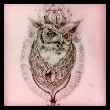 this black and grey pencil on paper realistic owl theme drawing is