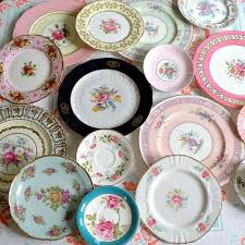 i the idea of mismatched vintage place settings for a wedding