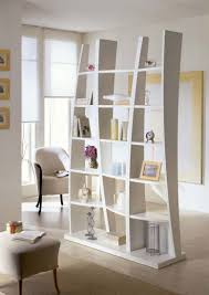 white wooden bookcase as room divider white fabric armchair cream