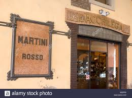 martini rosso martini rosso sign and bar imola italy stock photo royalty free