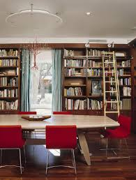 25 dining rooms and library combinations ideas inspirations view in gallery custom chandelier and fabulous red chairs add color to the home library dining room