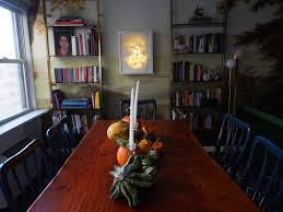 living dining room after the hyphenated home the table that fit all of those criteria and was pretty was a live edge trestle table from west elm it s no longer available i guess no else but us ever