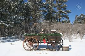 old wooden wagon decorated for christmas snowy scene used as