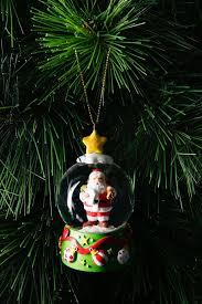 vue jingle bells santa in snowglobe myer online