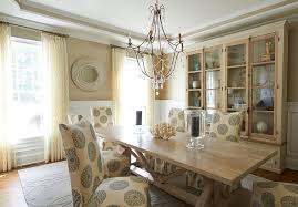 light gray dining table with cream leather dining chairs