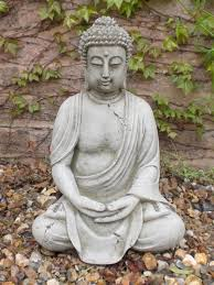large buddha statues make the yard a place of with a