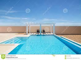 poolside pergola and infinity swimming pool stock photo image