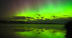aurora borealis northern lights aurora borealis northern lights over a river covered in mist stock