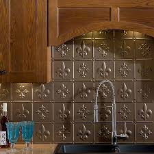 kitchen design stainless steel backsplash fleur de lis kitchen stainless steel backsplash fleur de lis kitchen decor under wooden kitchen cabinet and small bottle also two blue glasses over cream marble countertop near
