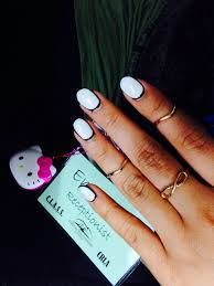 nails by vivian oval shaped with white gel nail polish and a