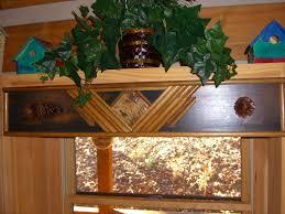 black cornice board over kitchen sink rustic window treatments