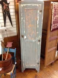 antique tall gray stained wooden kitchen pantry cabinet with stand