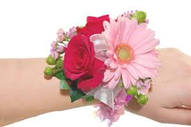 pink corsage hot pink spray roses and light pink mini gerbera wristlet