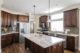 gourmet kitchen with dark kitchen cabinets large island with