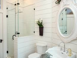 lovely small bathroom like the flowers over the toilet instead