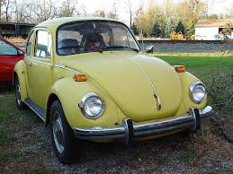 old volkswagen yellow old yellow volkswagen bug with embroidered flower power se u2026 flickr