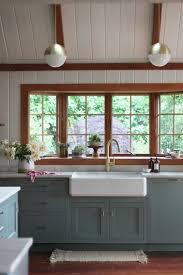 C Kitchen With Sink Warm Kitchen With White Shiplap Walls Hardwood Floors Gold