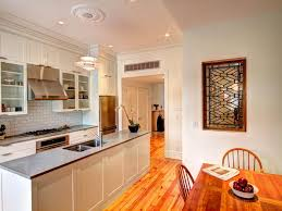 white shaker kitchen cabinets wood floors pine wood floor shines in white shaker kitchen hgtv
