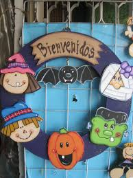 halloween door wreath with five faces witch scarecrow jack o
