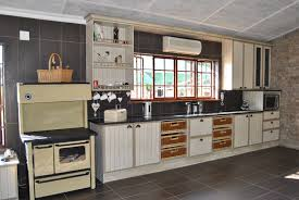 kitchen style kitchen cottage design stainless steel gas range kitchen cottage design stainless steel gas range open shelves black tile countertops white distressed cabinet