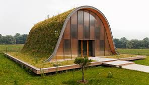 simple underground home and la maison vague wave house with meadow